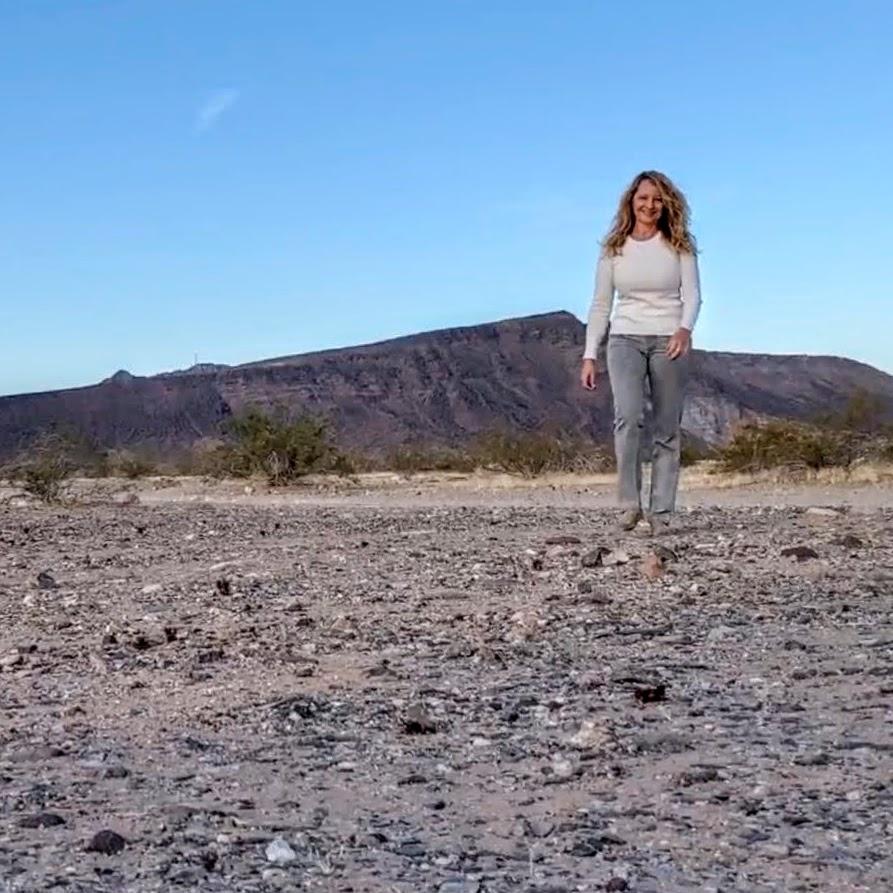 Woman walking in desert